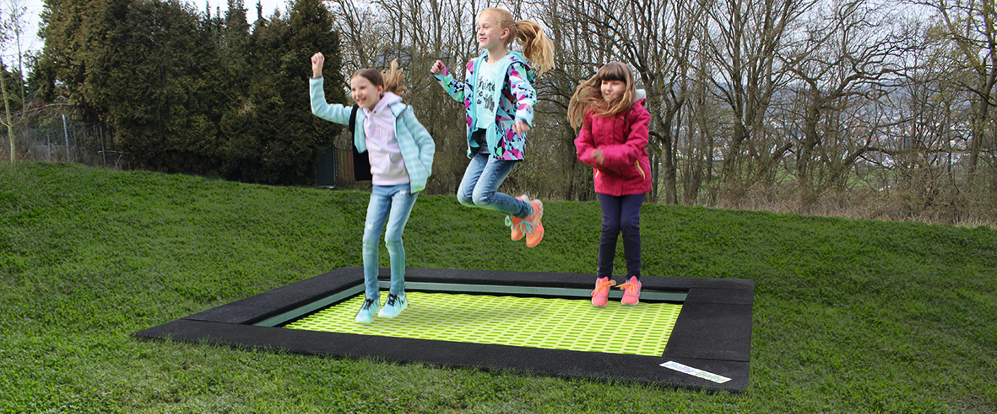 Trampoline with green mat